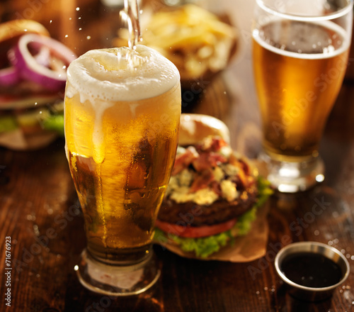 beer being poured into glass with gourmet hamburgers Tapéta, Fotótapéta
