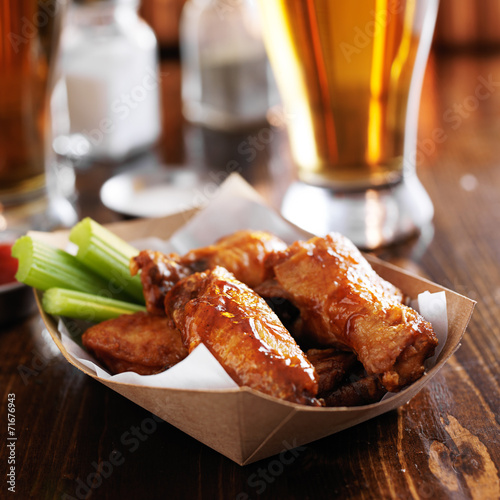 buffalo chicken wings in basket with celery and ranch