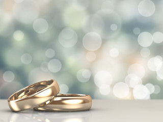FototapetaA pair of gold wedding rings with bokeh background