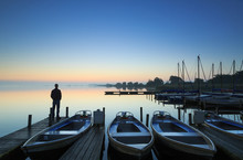Man Standing On A Jetty During...