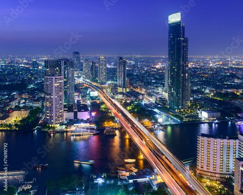 Photo Stands Bangkok Night view of Saphan Taksin bridge in Bangkok, Thailand