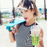 Sporty woman with color ball drinking water  - 71701185