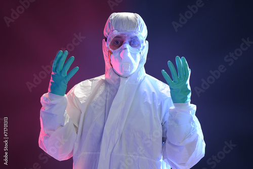 Fotografia  Scientist in full protective hazmat suit