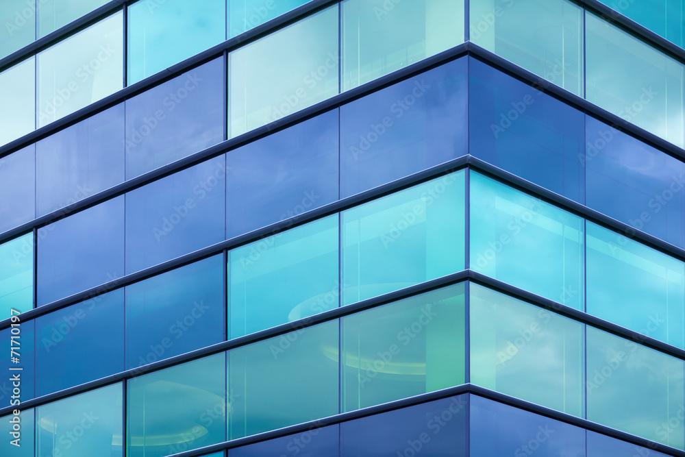 Fototapeta Modern office facade fragment with blue green glass