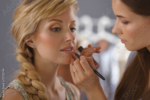 Fotografie, Obraz  Artist doing professional make up of woman