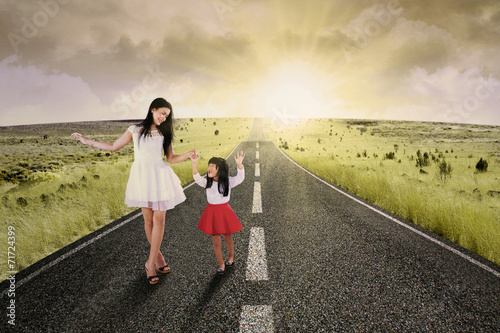 Fotografia, Obraz  Cheerful girl and her mother on road