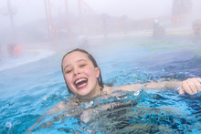 Young Girl Swims In The Outside Area Of A Thermal Poo