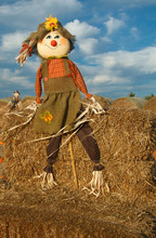 Fall Happy Scarecrow On Bales Of Hay At Pumpkin Patch