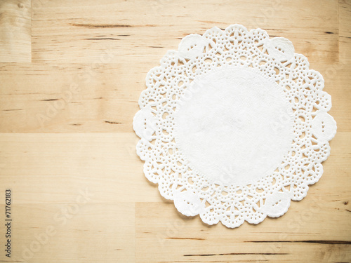 Valokuva  Lace paper on wooden table