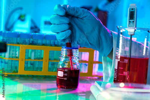 Vászonkép  researchers work in modern scientific lab. Preparation of hazard
