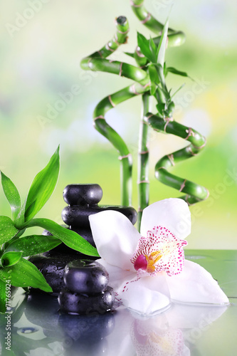 Spa stones, bamboo branches and white orchid - 71765924