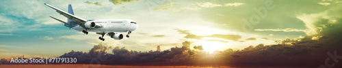 Fotomural Jet plane in a spectacular sunset sky