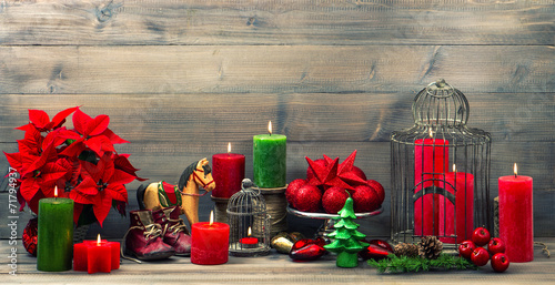 christmas decorations with red candles, flower poinsettia, stars - 71794937