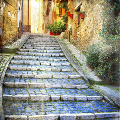 Fototapeta Schody charming old streets of medieval villages of Italy