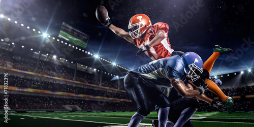 Photo American football player in action at game time