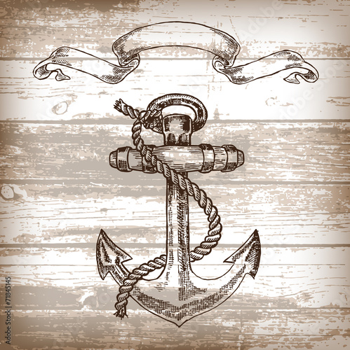 Photo  Vintage anchor on wooden background. Hand drawn vector