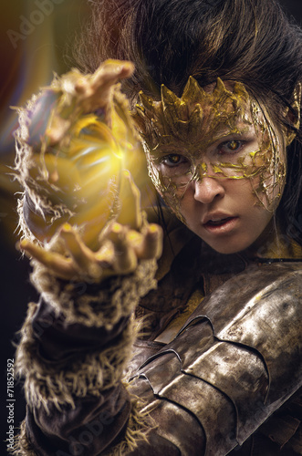 Woman in golden fantasy armour #71852592
