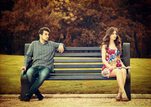 Young Couple Sitting Apart On ...