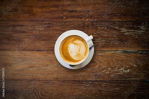Spoed Foto op Canvas koffiebar latte coffee on wood table.
