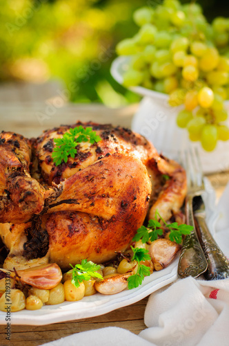 Fototapety, obrazy: Whole Roast Chicken with Grapes, Garlic and Almonds
