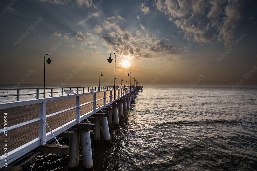 Fototapeta Sunrise on the pier at the seaside, Gdynia Orlowo,