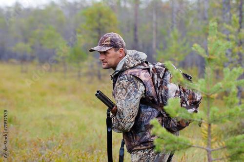 Fotobehang Jacht hunter holding a gun and waiting for prey