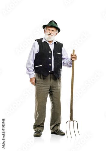 Obraz na plátne Old man with pitchfork isolated