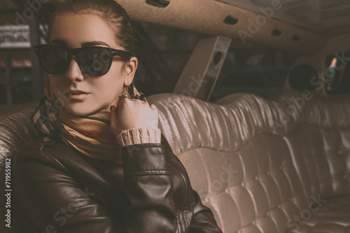 Young adult brunette girl looking away in limousine Poster