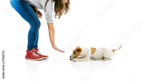 Valokuva  Woman training dog isolated