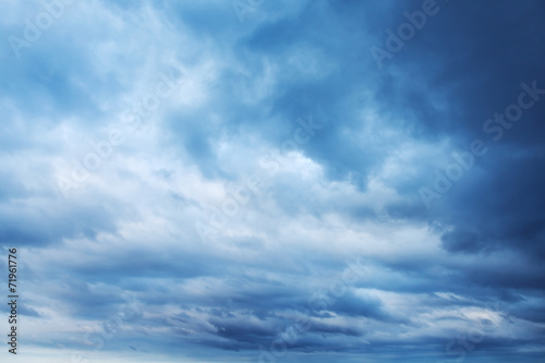 Tuinposter Hemel Dark blue sky with clouds, abstract background