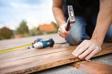 Handyman Installing Wooden Flo...
