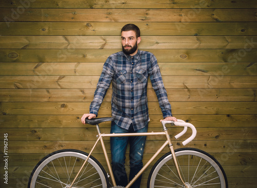 Fotografie, Obraz  Hipster man with his fixie bike