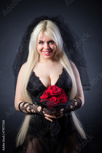 Photo  black widow in grief  with flowers  with a veil