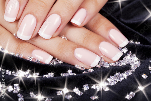 Staande foto Manicure Beautiful woman's nails with french manicure and diamonds.