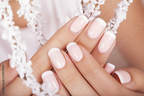 Foto op Canvas Manicure Beautiful woman's nails with french manicure.