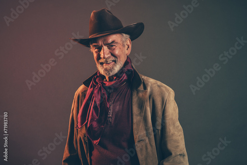 4b5231b98543e Smiling old rough western cowboy with gray beard and brown hat ...