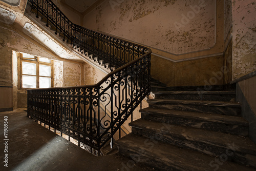 Abandoned staircase and hidden creepy hand