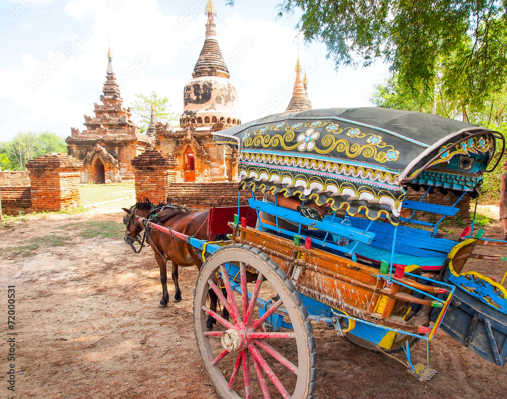 Fototapeta horse carriage and Daw Gyan Pagoda complex, Ava, Myanmar