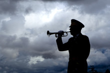 Silhouette Of Bugle Player.