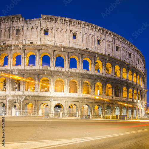 In de dag Rome Colosseum in Rome with car lighting, Italy
