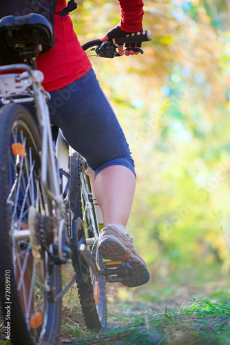 girl cycling in forest Tablou Canvas