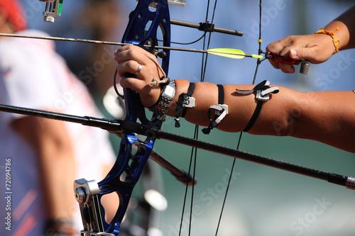 Fényképezés  Bow and arrow in the hands of an archer