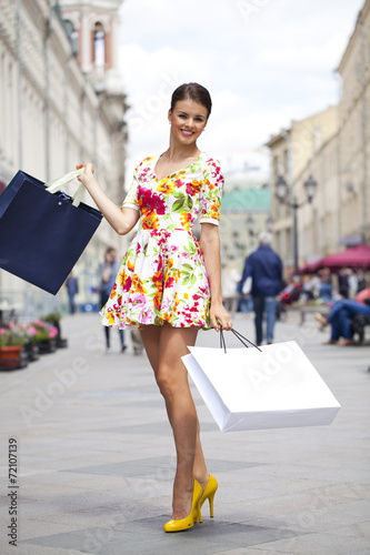 Beautiful young woman in flowers dress