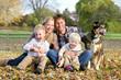 Leinwandbild Motiv Happy Family and Pet Dog Autumn Portrait