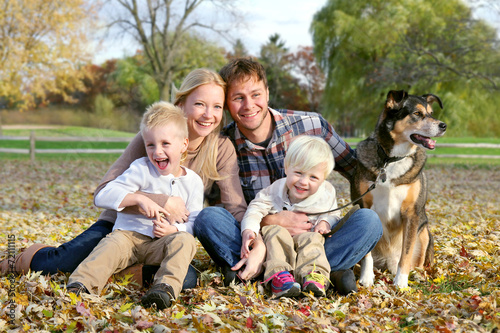 Fotografie, Obraz  Happy Family and Pet Dog Autumn Portrait