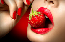 Sexy Woman Eating Strawberry. ...