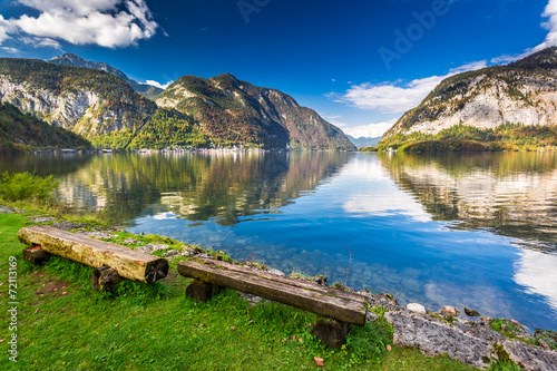 Fototapety, obrazy: Wooden bench at mountain lake in the Alps