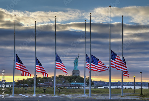 Fényképezés  US Flags at half staff in on September 11, 2014