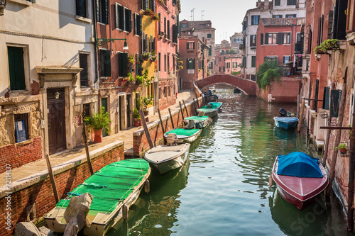 Boats and motorboats on a canal in Venice © shaiith