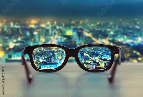 Night cityscape focused in glasses lenses Canvas